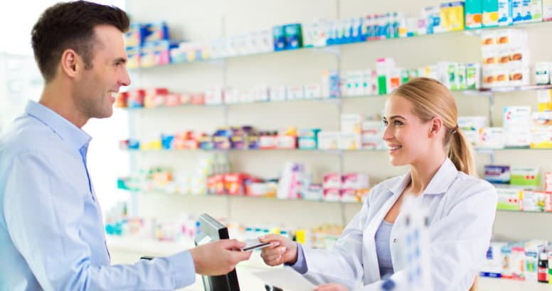 pharmacist giving the card to the man