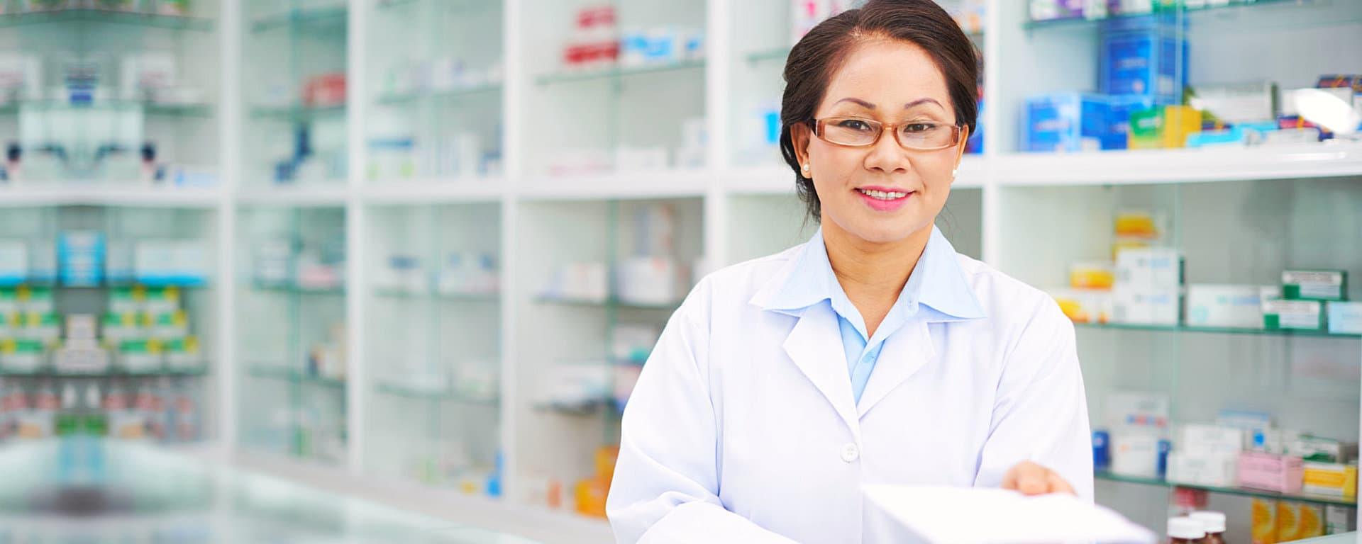pharmacist smiling on the pharmacy