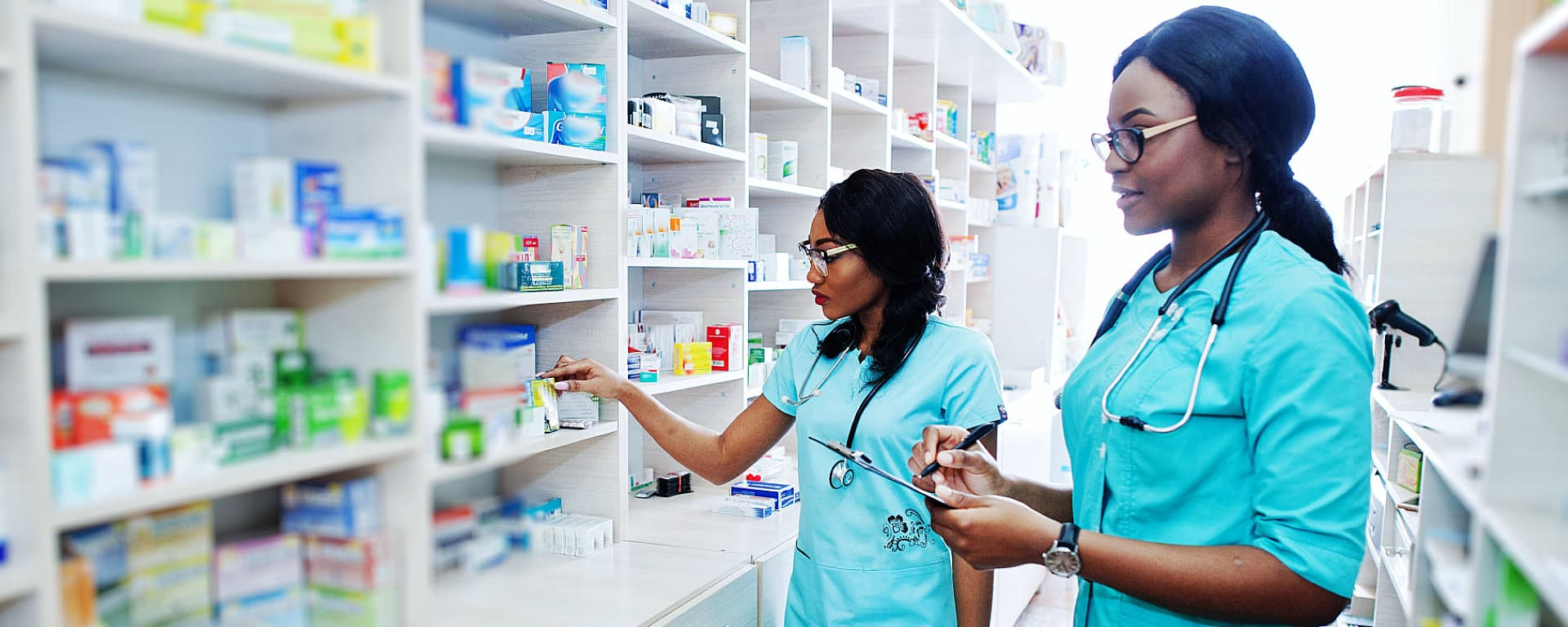 two pharmacists checking some medicines